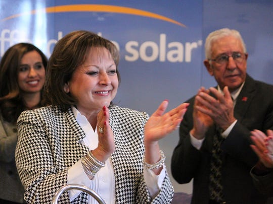 Gov. Susana Martinez, center, and other officials celebrate the selection of two New Mexico companies to build a 30 megawatt solar project to power Facebook's new data center during a news conference in Albuquerque, N.M., on Wednesday, Feb. 1, 2017. New Mexico's largest electric utility is investing a total of $45 million in the 30-megawatt solar project, with most of that going to Albuquerque-based Affordable Solar for the installation of tens of thousands of panels.