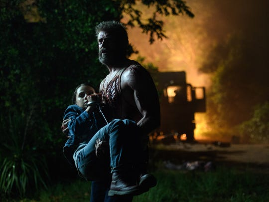 Logan (Hugh Jackman) saves young Laura (Dafne Keen) in 'Logan.'