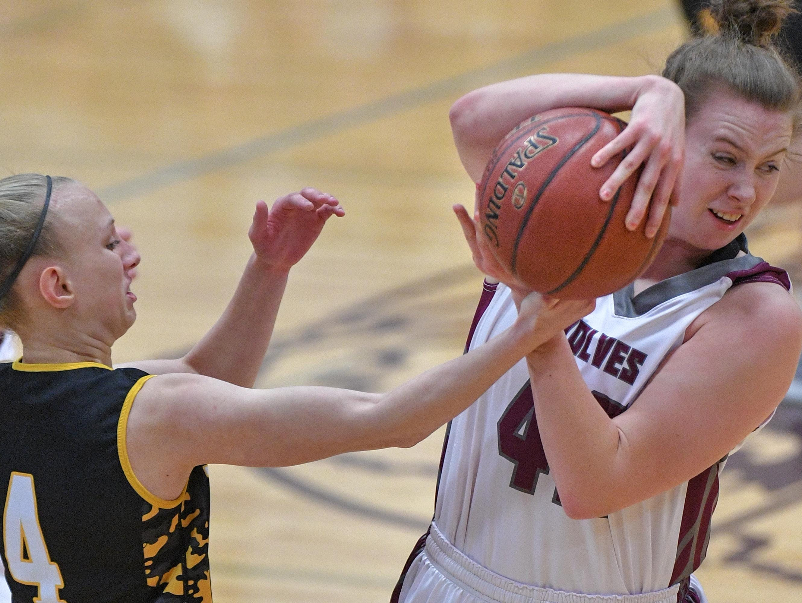 Sadie Kosciuk, right, of Winneconne tries to keep Tiana Gaubatz of Waupun from stealing the ball Thursday in Winneconne.