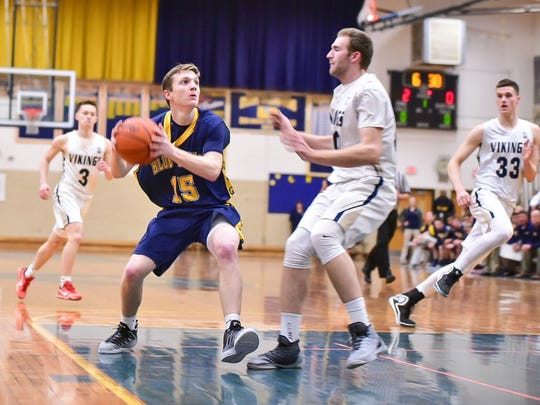 Upper Merion's Ethan Miller, right, guards Ian Gelsinger, of Greencastle-Antrim, during a PIAA Class 5A first-round boys basketball game on Friday, March 10, 2017. The Vikings won, 62-46.