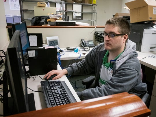 Project SEARCH intern Cody Rautanen, 21, inputs warranty and repair into a computer as part of his duties on Feb. 8, 2017 in Cherry Hill, N.J.