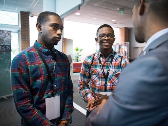 Benjamin Jennings, a senior at D.W. Daniel High School, and Kameron Hanks, a freshman at Seneca High School, speak with Greg Hedgepath with Florida Atlantic University during Clemson University's Men of Color National Summit at the TD Convention Center on Friday, April 28, 2017.