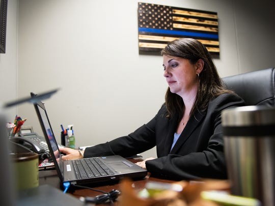 Captain Ty Miller with the Greenville County Sheriff's Department works in her office on Monday, May 8, 2017.