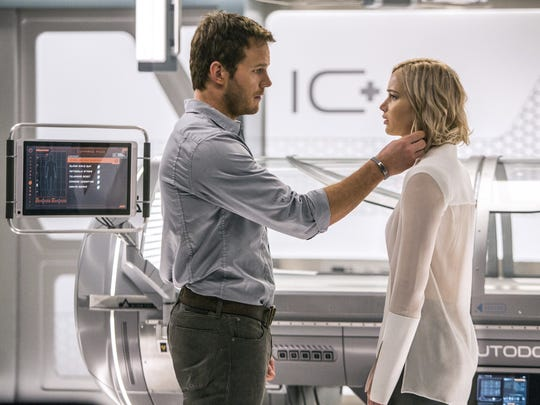 """Jim (Chris Pratt) and Aurora (Jennifer Lawrence) wake up 90 years too early on their space flight to a distant settlement in """"Passengers."""""""