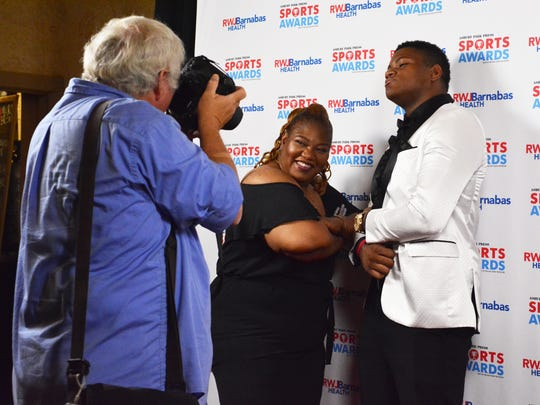 (SPORTS)           06/14/17      Red Bank, NJ SJV's Micah Clark (right) works the Red Carpet with his mom during the Asbury Park Press Sports Awards at the Count Basie Theater in Red Bank.