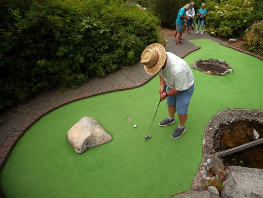 Wendell Crim, 68, of Seabeck, sinks a putt during the