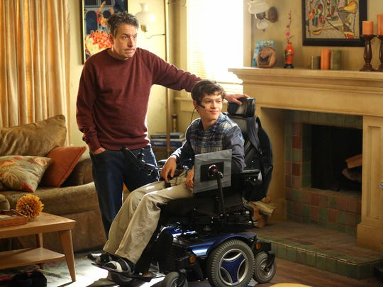 "John Ross Bowie as Jimmy and Micah Fowler as J.J. on ""Speechless"""