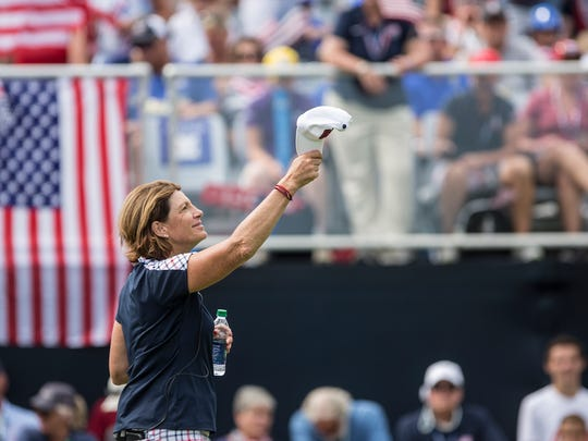 Juli Inkster, captain of Team USA watches as players tee off on the first hole for the final round of the Solheim Cup on Sunday, August 20, 2017, in Des Moines.