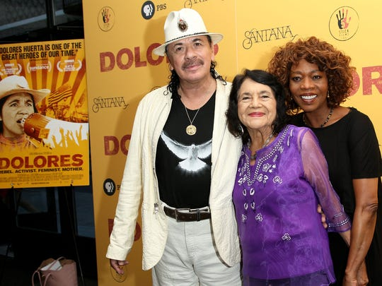 "Executive Producer Carlos Santana, documentary subject Dolores Huerta and actress Alfre Woodard arrive for the ""Dolores"" New York premiere at The Metrograph on Monday, in New York."