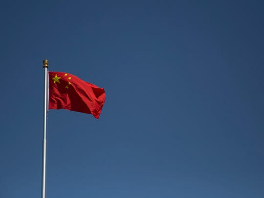 The Peoples Republic of China flag flies over Tiananmen