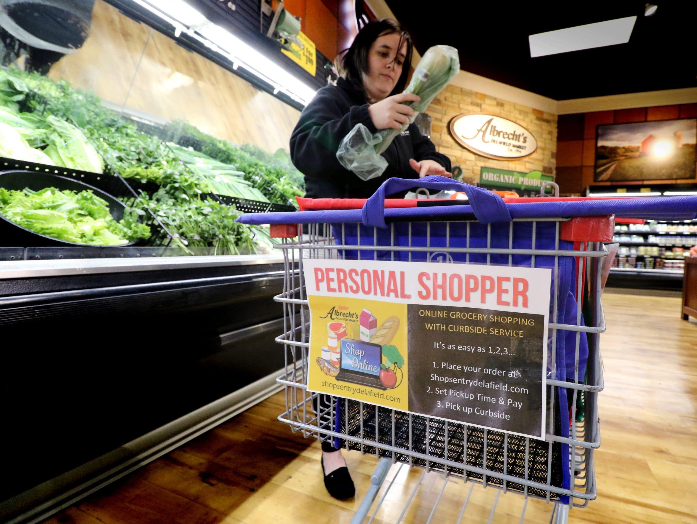 Courtney Jeanpierre picks produce for a customer's