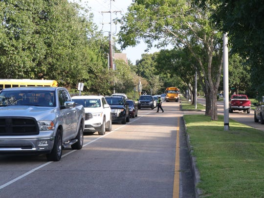 Vehicles line up to drop off students on the first