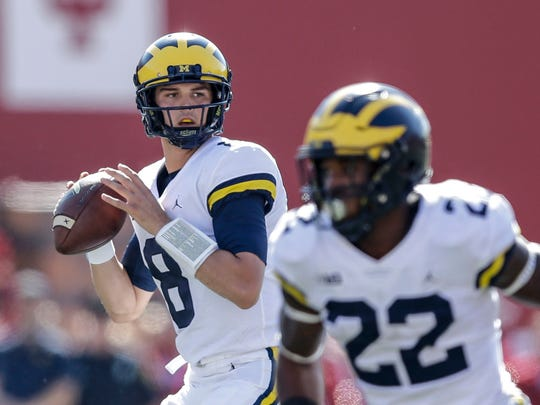 Michigan quarterback John O'Korn drops back to throw during the first half against Indiana in Bloomington, Ind., Saturday, Oct. 14, 2017.