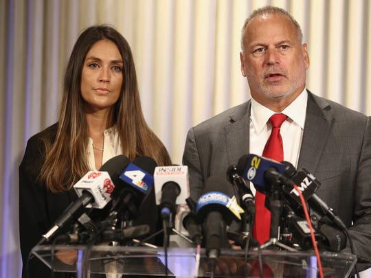 Dominique Huett and her attorney Jeff Herman speak during a press conference on Wednesday.
