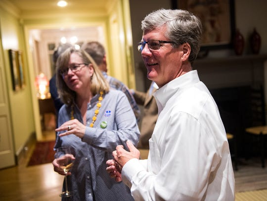 Russell Stall and his wife Susan speak with supporters