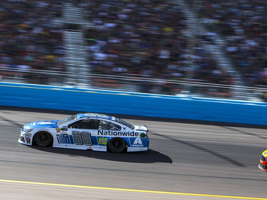 Dale Earnhardt Jr. goes around a turn during the Can-Am 500 on Sunday at Phoenix Raceway in Avondale.