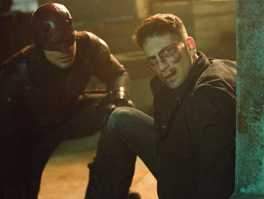 The Punisher (right, Jon Bernthal) met Daredevil (Charlie
