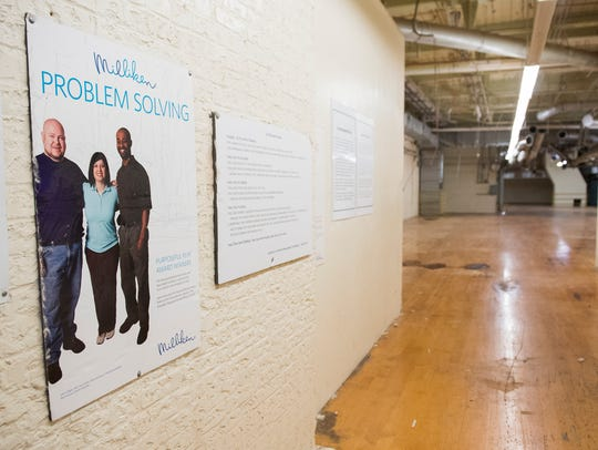A Milliken sign is displayed on a wall inside the Judson