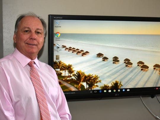 Stan Niemczyk at the Keller-Williams Realty office. He was named Marco Island Volunteer of the Year at the chamber of commerce gala Sunday night. Lance Shearer/Special to the Naples Daily News