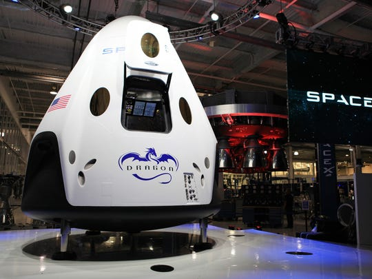 SpaceX's Crew Dragon spacecraft is seen at the company's Hawthorne, California headquarters at its 2014 unveiling.