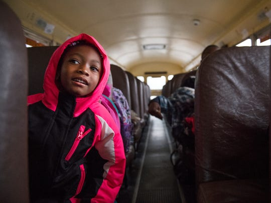 Kindergartner Toni Doctor rides the bus to Fork Shoals