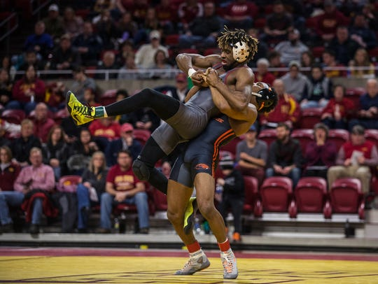 Iowa State's Markus Simmons wrestles Oregon State's