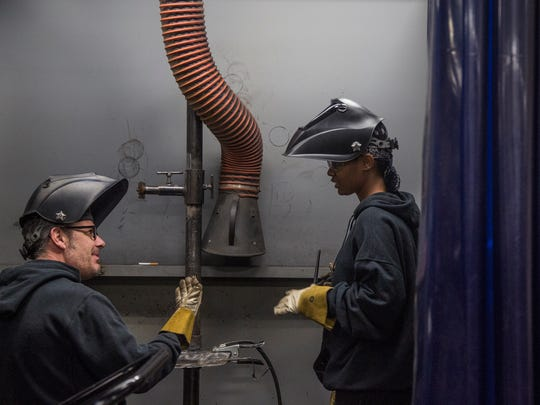 Robert Allison, a DMACC welding instructor works with one of his students, Myleka Fox on Wednesday, Jan. 10, 2018, at the Iowa Welding Institute in the DMACC Southridge Center in Des Moines. DMACC moved into the former JC Penny wing of Southridge Mall and remolded it into a campus with the wedding lab, automotive technology labs and traditional classrooms.
