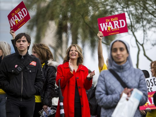 U.S. Senate candidate Kelli Ward claps during the Arizona