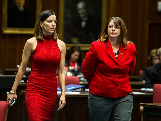 Rep. Michelle Ugenti-Rita walks with Rep. Kelly Townsend after House legislators voted to expel Rep. Don Shooter from office on Feb. 1, 2018 at the Arizona House of Representatives chambers in Phoenix.