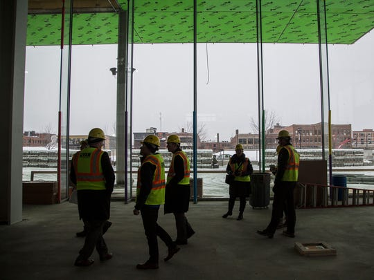 A tour group walks through the inside of the Krause Gateway Center and new headquarters of Kum & Go on Tuesday, Feb. 6, 2018, in downtown Des Moines. The $151 million project is expected to be complete in October.
