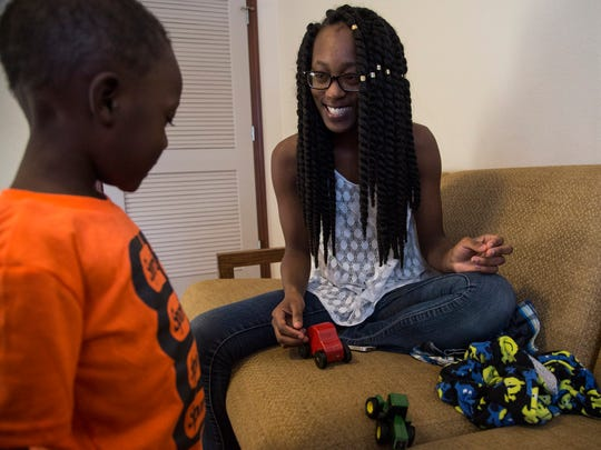 Imani Long, 20, of Des Moines, plays with her three-year-old