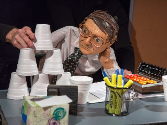 "Frank stacks cups in ""The Pigeoning"" at OZ Arts Nashville."