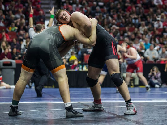 Clarion-Goldfield-Dows' Spencer Trenary wrestles Solon's Tyler Linderbaum during the Iowa high school state dual team wrestling quarterfinal on Wednesday, Feb. 14, 2018, in Wells Fargo Arena.