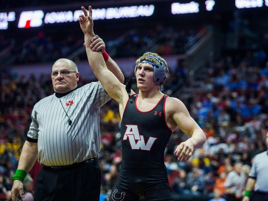 Akron-Westfield's John Henrich wins his match against St. Albert's Jackson Dunning during the first round of the Iowa high school state wrestling championship on Thursday, Feb. 15, 2018, in Wells Fargo Arena.