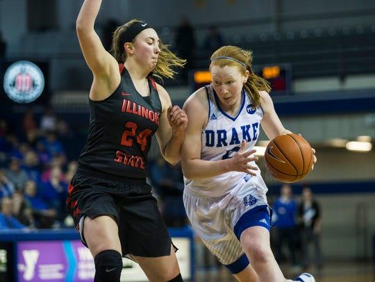 Drake's Becca Hittner drives to the hoop during the