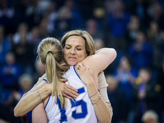 Drake's Paige Greiner gets a hug from her coach Jennie Baranczyk on senior night after the Drake women's basketball game against Illinois State on Sunday, Feb. 25, 2018, in the Knapp Center. The Bulldogs won their final home game, 80-64.