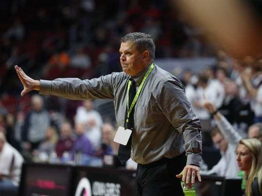 Iowa City West Coach BJ Mayer calls out a play during the Class 5A Girls' state basketball quarterfinal game between Dowling Catholic and Iowa City West on Monday, Feb. 26, 2018, in Wells Fargo Arena.