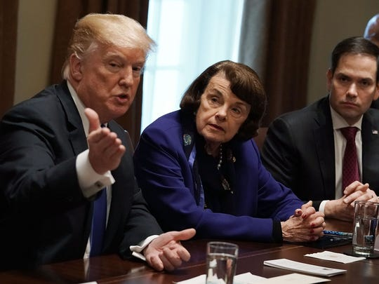 President Donald Trump speaks as Sen. Dianne Feinstein (D-CA), Sen. Marco Rubio (R-FL) and Rep. Ted Deutch (D-FL) listen during a meeting with bipartisan members of the Congress at the Cabinet Room of the White House February 28, 2018 in Washington, DC.