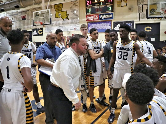 Carencro high school basketball coach Christopher Kovatch instructs his pleayers as the Golden Bears take on the Easton Eagles in the Class 4A quarterfinals Saturday, March 3, 2018.