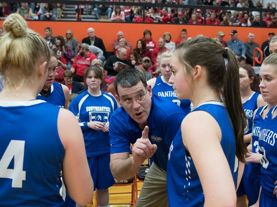 Southeastern head coach Mike Adams talks to the Panthers' girls team during a game against Minford.