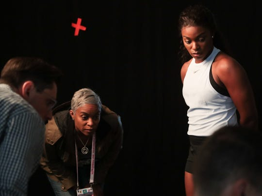 Sloane Stephens and her mother look at photos taken during a WTA photoshoot, Sunday, March 4, 2018.