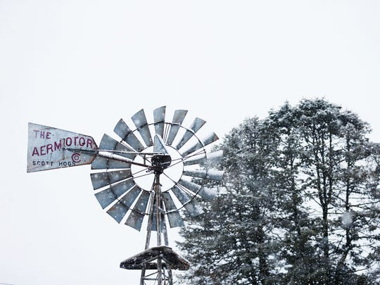 A late winter snow falls on the Iowa State Fairgrounds on Sunday, March 11, 2018, in Des Moines.