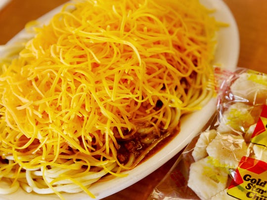 Cincinnati-style chili is covered with a mound of shredded cheddar.