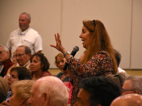 An audience member gives her views on traffic  congestion. Collier County Commissioner Donna Fiala held a Town Hall meeting Wednesday evening at the South Regional Library, in a room packed with about 350 constituents and county officials.