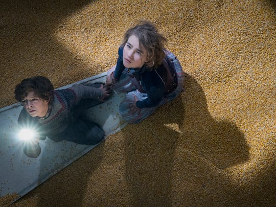"Noah Jupe and Millicent Simmonds in ""A Quiet Place"" from Paramount Pictures."