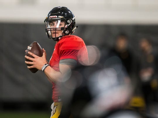 Iowa football quarterback Nate Stanley looks for a place to pass the ball during a spring football practice on Wednesday, March 28, 2018, at the Iowa football performance center in Iowa City.