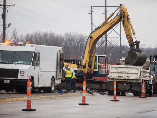 Des Moines Water Works repairs a water main break on 63rd Street in Des Moines on Tuesday afternoon, April 3, 2018. The break closed one lane in both directions while crews worked on the repair.