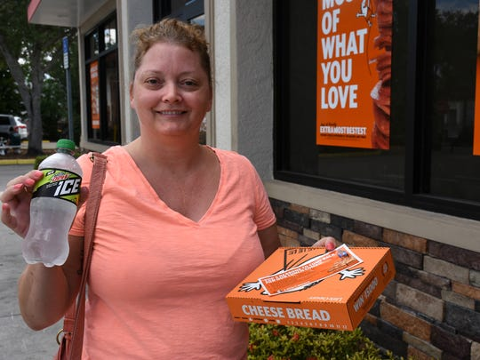 Wendy  Soto's boss sent her to collect a free lunch. Little Caesar's pizza parlors made good on a March Madness bet on Monday, giving away free pizza to all comers at lunchtime.
