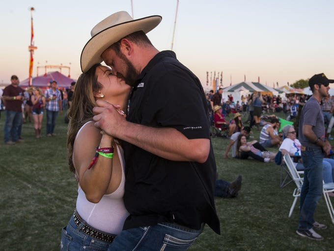 Kelsy Stephens and Max Baumann kiss during Cody Johnson's