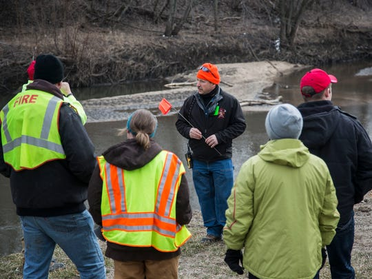 Volunteers search for clues to the disappearance of